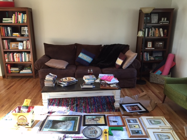 Here is how my living room was arranged before, and you can see my draft of the gallery wall.  Many thanks to Carrie for helping me edit the art and arrange it artfully.